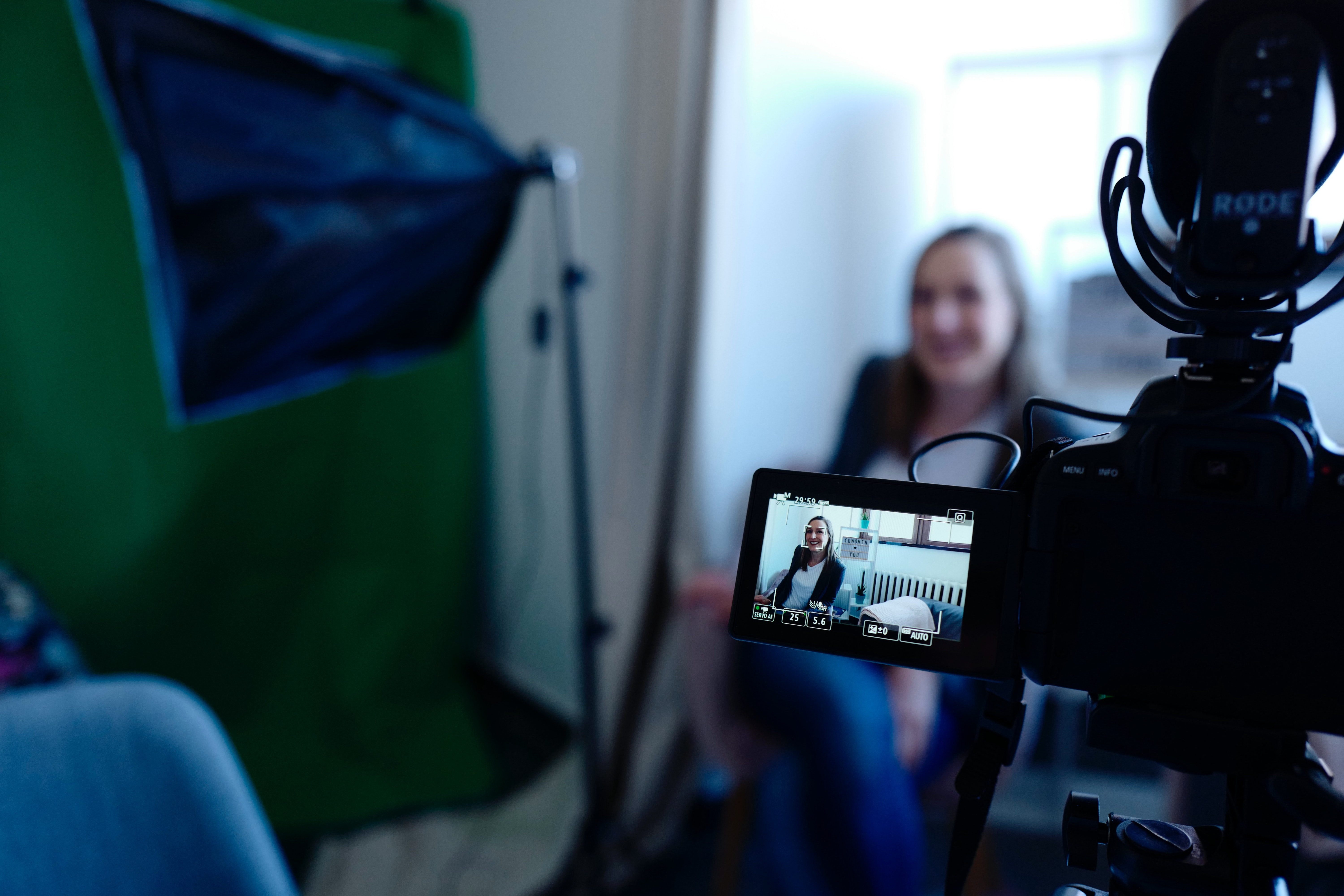 image of a person being recorded on a video camera to illustrate video marketing myths